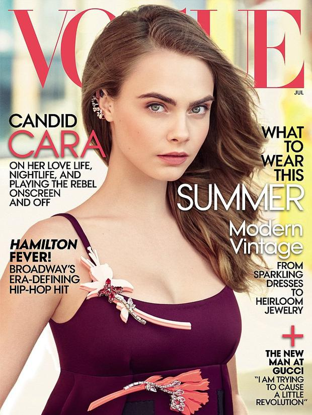 Cara delevingne poses topless for magazine entertainment photo 2