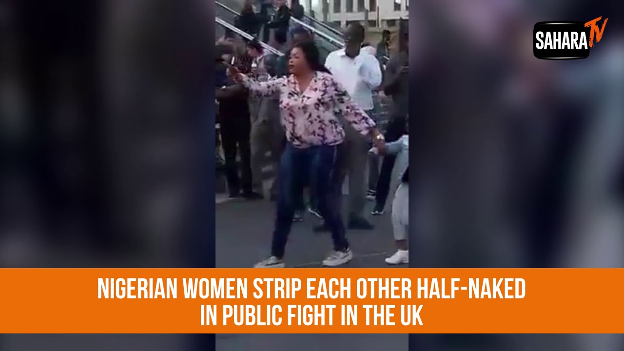 Women ripping each others clothes off