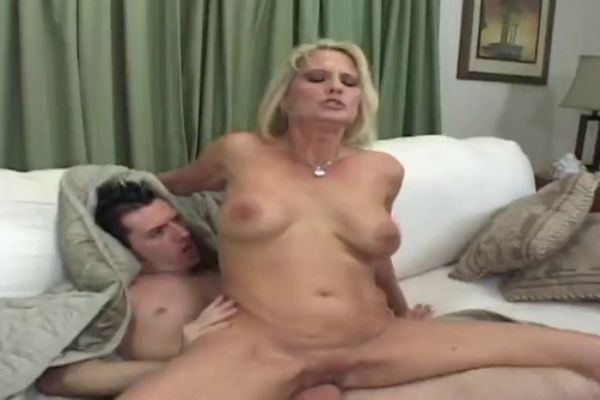 Sexy blonde chick with small tits sucking dick head