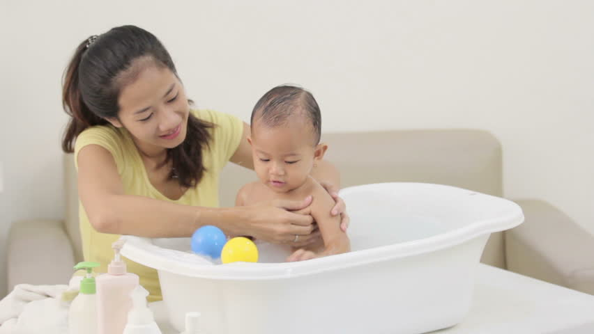 Son on his mom while taking her bath