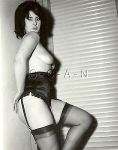 Woman in stockings and corset photo 2